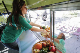 "A student studying business and his wife studying social work teamed up on a plan to retrofit buses as mobile markets to bring nutritious offerings to ""food deserts."" (EPA/Newscom)"