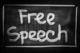 "A sign that reads ""Free Speech"""