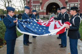 members of UNH ROTC holding an American flag