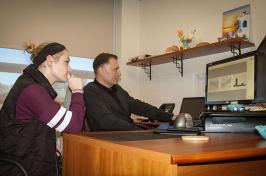 Megan Duranko '17 and Professor Sergios Charntikov discuss research data