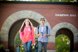 Students walking under the Thompson Hall arch at UNH