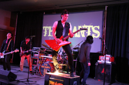 The Slants on stage at a show