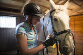 a student and a horse at the University of New Hampshire