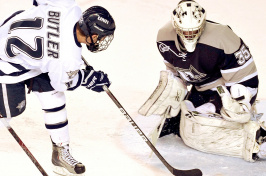 UNH alumnus Bobby Butler playing hockey at UNH