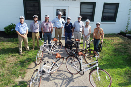 UNH facilities staff with bikes and helmets