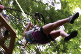 a UNH Cooperative Extension 4-H member using a zipline at Candia Springs