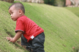 boy climbing hill