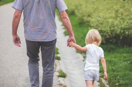 Image of child holding someone's hand