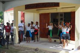 children dancing in front of museum