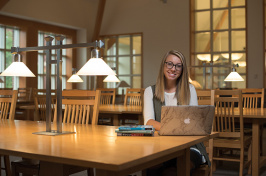 UNH student Charlotte Harris in the library on the Durham campus