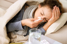 image of person at home with a cold