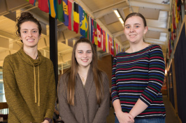 UNH students with international flags