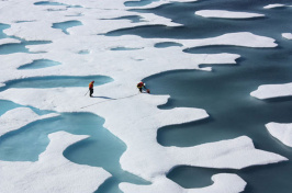Two members of NASA's ICESCAPE mission, a shipborne investigation researching how changing Arctic conditions affect the ocean's chemistry and ecosystems. (Photo: NASA/Kathryn Hansen, Flickr CC BY 2.0)