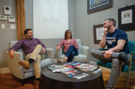 UNH alumnus Matt Saunders '92, '05 JD, meets with associates Becky Lessard and Seth Walters in their Amesbury offices