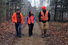 UNH Cooperative Extension's Karen Bennett with others in the woods