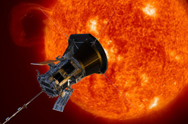 A silver octagonal probe approaches the red-hot surface of the sun.