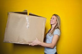 image of woman with moving box, pexels.com
