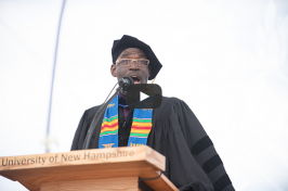 """UNH College of Liberal Arts Associate Dean Reginald Wilburn singing """"America the Beautiful"""" during commencement 2018"""
