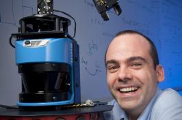 Professor Wheeler Ruml beside a robot