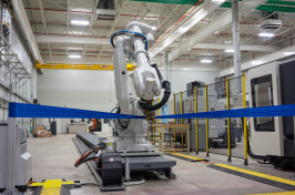 A robot at work in UNH's John Olson Advanced Manufacturing Center