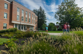 Paul College exterior view with students walking