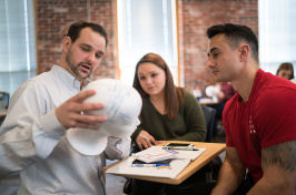 UNH psychology professor Daniel Seichepine working with students