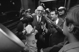Dr. Benjamin Spock talks with newsmen outside the Federal Building in Boston, Jan. 29, 1968, after pleading innocent to charges of counseling young men to avoid the draft. (J. Walter Green/AP)