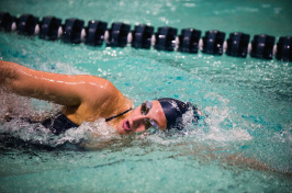 A UNH swimmer in the pool at the 2018 America East Championship