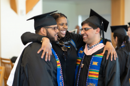 UNH graduates celebrating during pre-commencement reception in library