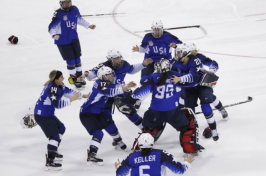 US women's hockey team celebrating winning gold at the Olympics