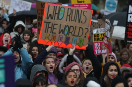 Protesters hold up placards during the Women's March in London on Jan. 21, 2018