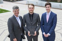 YouScheduler teammates Kristian Comer and Francesco Mikulis-Borsoi pose with their faculty advisor, Ian Grant.