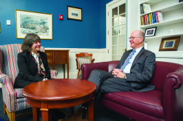 Jan Nisbet and James Dean talk in his office