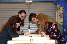 UNH professor Nancy Kinner and students at work in a lab