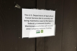 Image of sign saying how govt shutdown closed facility temporarily