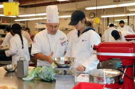 Professor Charlie Caramihalis instructs a student in the new Culinary Nutrition and Food Studies minor