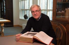 photo of Douglas Lanier with Shakespeare Folio