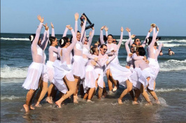 UNH's dance team by the ocean