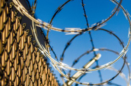 photo of barbed wire against sky by Robert Hickerson on Unsplash