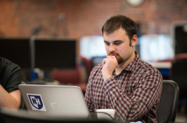 A UNH student working at a computer