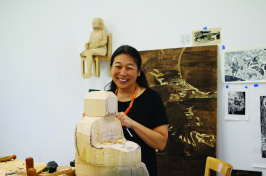 Sachiko Akiyama works on a large wood sculpture