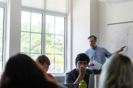 photo of Nick Smith teaching an Honors class