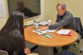 UNH Student practices interviewing with UNH CaPS CEPS Mock Interview Day
