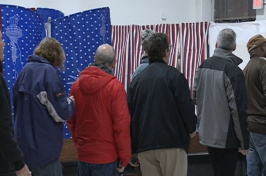 Image of people waiting to vote.