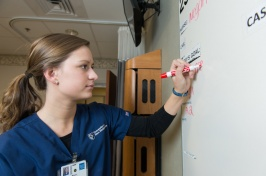 nursing student working on white board