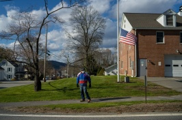 Person walking in a rural neighborhood