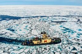 Icebreaker cuts through sea ice.