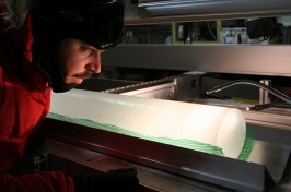 Joe Souney inspects an ice core from Antarctica.