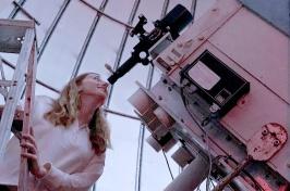 Morgan Saidel looking through telescope at Cornell University