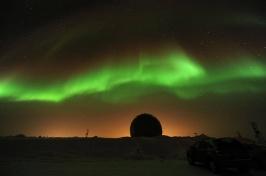 Northern Lights dance across the night sky